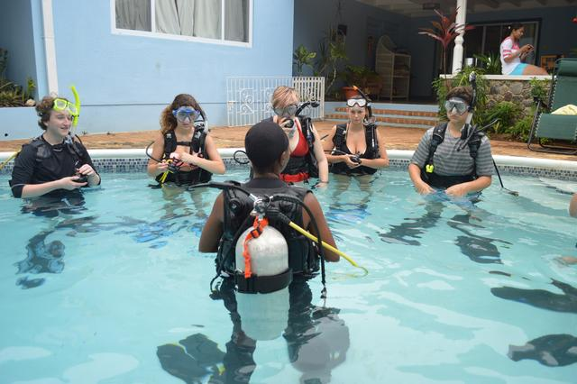 Campers trying on their SCUBA gear.