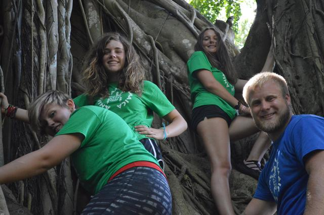 3 campers and a staff climbing a larger-than-life Banyan tree!