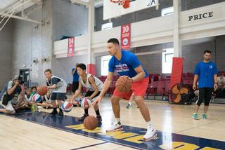 Ben Simmons working with campers